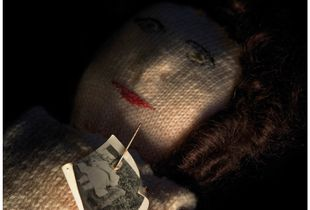 Knitted poppet with Photograph