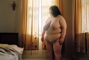 Mary Jane Foster stands nude in her bedroom in East Liverpool, Ohio.