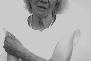 """Anni Schmidt was a Sinti woman and was deported in World War II to the Ausschwitz Concentration Camp run by the Nazis, proved by """"the Registration number"""" she is still bearing on her arm ."""