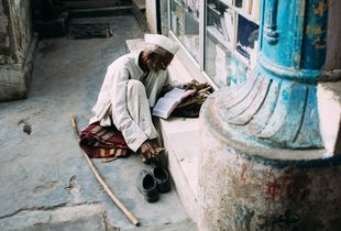 Man immersed in his reading. Madurai.