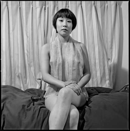 Jean RAULT-Young dark hair woman wearing a simple scarf on her shoulders. Tokyo, Japan