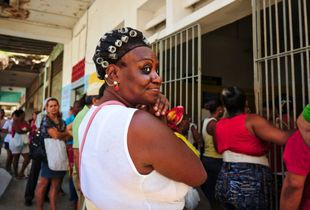 Waiting for the opening time at a non-state grocery store in downtown Havana. Despite not having food shortage issues, finding better quality produce could mean that getting to the grocery before everybody.