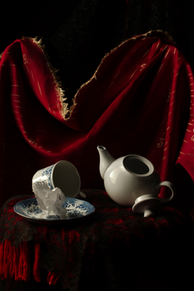 Still-life with drapery, porcelain, and loose-leaf