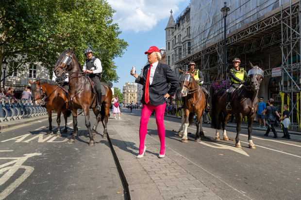 Trot on Trump; A Protester at the National Demonstration 'Together Against Trump' on 13 July 2018. Cockspur Street, Westminster, London. 2018.