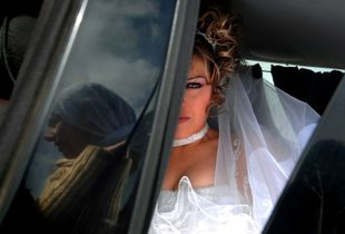 Arwad Abu Shaheen, a 25 year-old bride from the Druze village of Bukata, Golan Heights, sits at her wedding car as she leaves her home and Israel, to marry her fiancé in Syria. Since Israel and Syria are enemy states, Arwad would not be able to return to the Israeli-controlled Golan Heights.