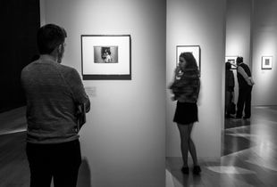 Lady in front of a portrait (tribute to Diane Arbus)