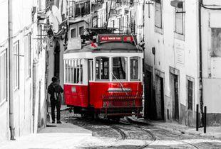 Tram on a narrow street, Lisbon, 2019