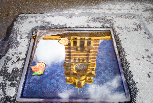 Flinders Street Station reflected.