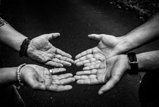 Two residents show their hands during a walk