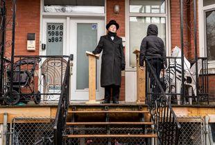 Hasidim Jews pray outside because of COVID-19