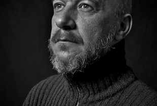 Portrait of a man with a turtleneck sweater.