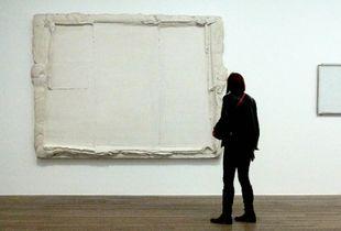Anoymous Woman Admires Art at Tate Modern London