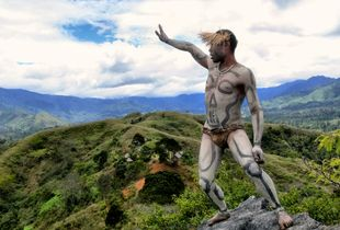An Asaro young man showing  the territory around his village. Eastern Highlands, Papua New Guinea