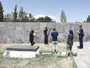Turkish citizens who rediscovered recently their Armenian origins. They are visiting the Tsitsernakaberd memorial and taking pictures near the inscription of their home city: Diyarbakir (Tigranakert in Armenian).