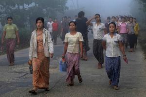 Factory workers from Yuzana Garden City walk to their work in Yuzana Garden City, Yangon, Myanmar.