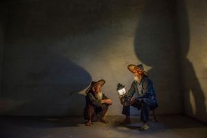 Cormorant fishermen reflecting their shadows on the wall