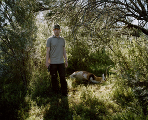 untitled hunter, hand gun and lechwe, eastern cape, south africa-from the series 'hunters'-David Chancellor