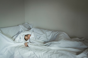 Ilaria, 45, in her house in Besnate (Lombardy) wrapped in a shielding sheet that protects her during the night.