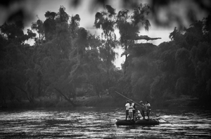 A group of Central American Refugees float across the Guatemalan/Mexican border on the Suchiate river border between Ciudad Hidalgo, Chiapas Mexico and Tecun Uman, Guatemala.