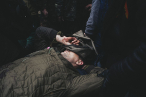 Protesters carry those who died of snipers, from hospital to Mikhailovska church, where relatives identify them. Kiev, Feb. 20, 2014.