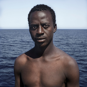 Mediterranean Sea, 1 August 2016. Momodou (18), from Guinea, poses for a portrait minutes after being rescued on the Mediterranean Sea, 20 nautical miles off the Libyan coast by a rescue vessel provided by the NGO Jugend Rettet. The rubber boat in which he travelled carried 118 people on board, who were transferred by the Italian Coast Guard to Lampedusa (Italy).