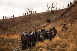 Authorities face protestors as they block them from proceeding further towards the construction site of the Dakota Access Pipeline on Army Corps of Engineers land in Cannon Ball, North Dakota in November 2016.