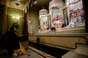 Devotees observe the evening temple ceremony - Gaura Arati