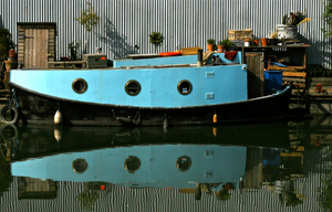 Turquoise And Black Houseboat