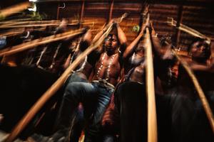 Men using the Tablon & Singing