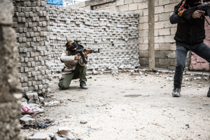 A female and male guerilla fighter (Deniz Bagok) of the YPS while training between high barricades in Kurdish-dominated city of Nusaybin in southeast Turkey, near the Syrian border. Heavy gunfights took place during several curfews between Turkish government special forces and Kurdish YPS guerilla fighters.