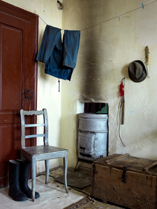 Ianos's trousers, hat, boots & whip drying by the stove, Messendorf 2015