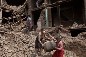 Nepali residents clear rubble and collect items from their destroyed homes in Bhaktapur, Nepal.