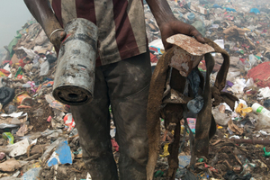 Amidst the garbage a waste picker finds some iron that he can sell. More than 1000 waste pickers look for recyclable items every day.