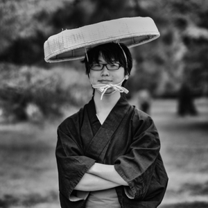 Young man with Glasses and big hat