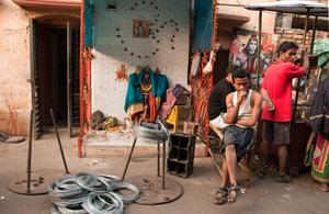 Wire seller in front of a shrine, Shyambazaar, Kolkata