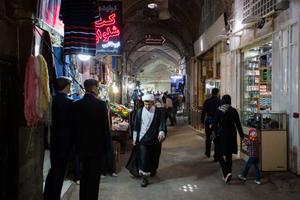 A mullah walks through the bazaar of Isfahan.