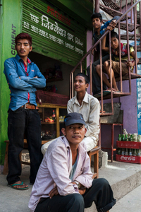 Young boys sit outside the grocery store at Belaphi, Sindhupalchok