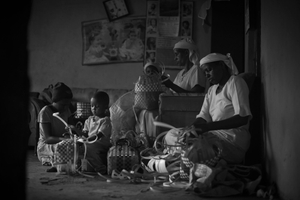 Three generations of Shona women weave baskets on the floor of their home in the town of Githurai on the outskirts of Nairobi, Kenya, on October 25, 2017.