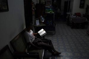 Former journalist read at night in Yuzana Garden City, Yangon, Myanmar.
