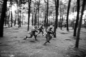 Indonesian men dressed up as German Waffen-SS soldiers run through a pine forest and simulate combat during a gathering of re-enactment enthusiasts in Cibubur, East Jakarta, Indonesia.