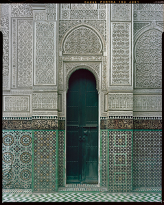 Stucco and tile at Bu Inaniya Madrasa in Meknes, Morocco.