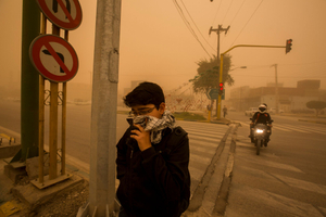 Silent Death, 2015. A boy covers his mouth to protect himself from pollution. On the streets of Ahvaz, one of the world's most polluted cities.