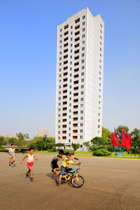 Apartment block and paying kids in the centre of Pyongyang.