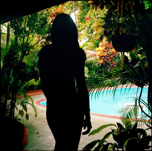 Cristal outside a Sosúa hotel room, after an overnight outcall