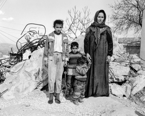 palestinian family outside their demolished house