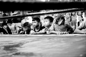 Young boys are watching a boxing match. Sometimes they fight also. © Sandra Hoyn