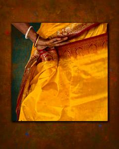 Folding, marigold and puce sari