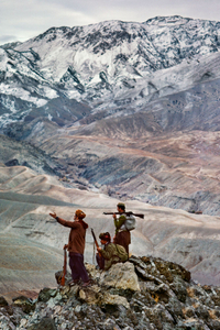 Mujahideen atop a mountain. Logar Province, Afghanistan, 1984. The road at the bottom of the mountain links two provinces, affording these fighters the ability to see government vehicles passing below their observation point.