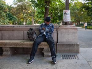 Seated Man  At Columbus Circle  Park Entrance