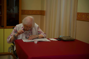 """Mrs Rosa Silva, 93 years old, concentrated to risolve a brain teasers paper game on """"La settimana enigmistica"""", a very good exercise for the mind."""